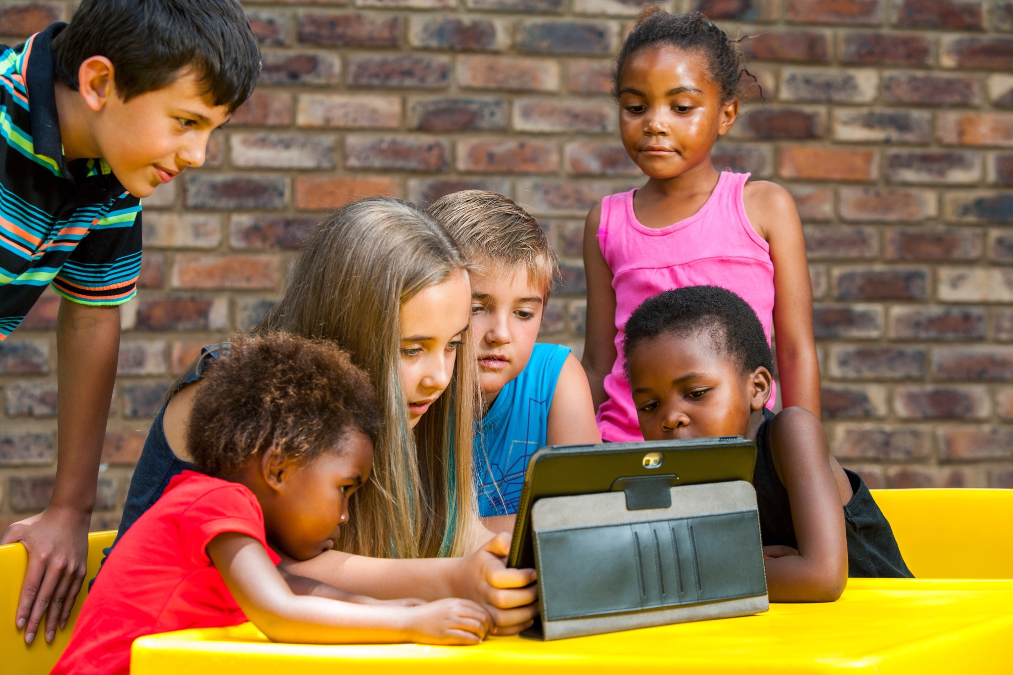 Children looking at a tablet