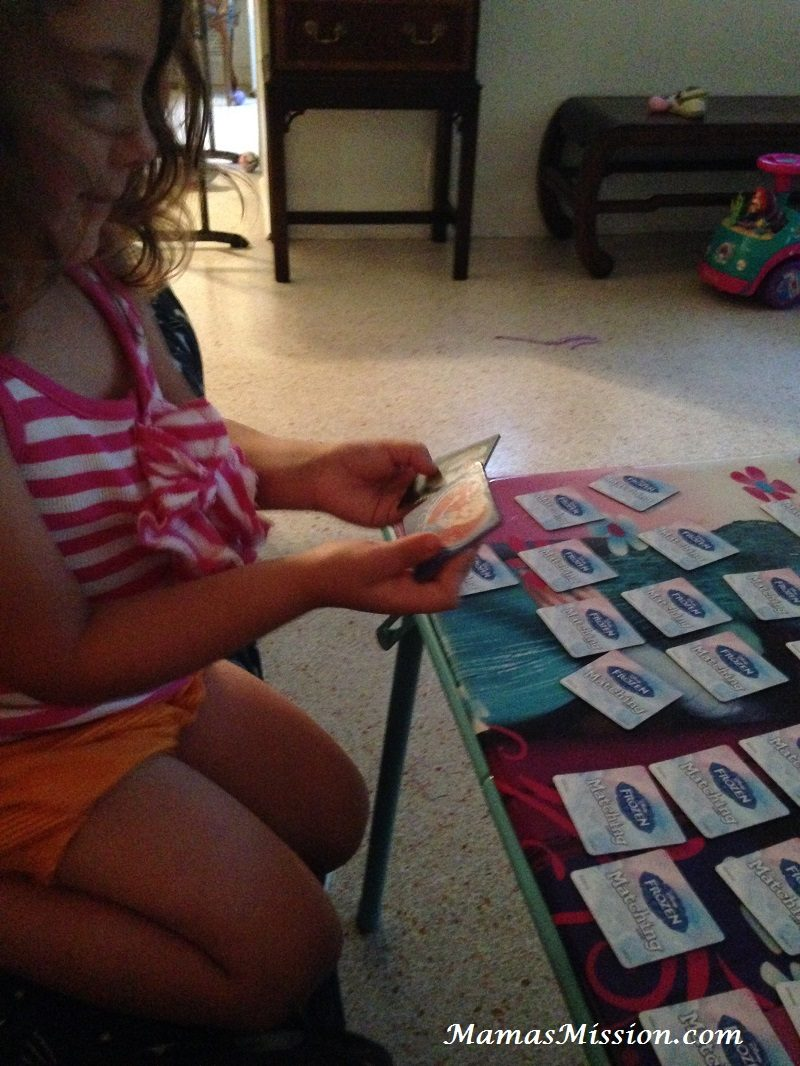 Em playing Disney Frozen Matching Game for preschool kids