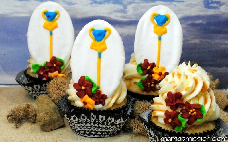 These Elena of Avalor Cupcakes will be a real hit for your next themed party. Decorated with Elena's scepter and beautiful flowers - save this recipe!