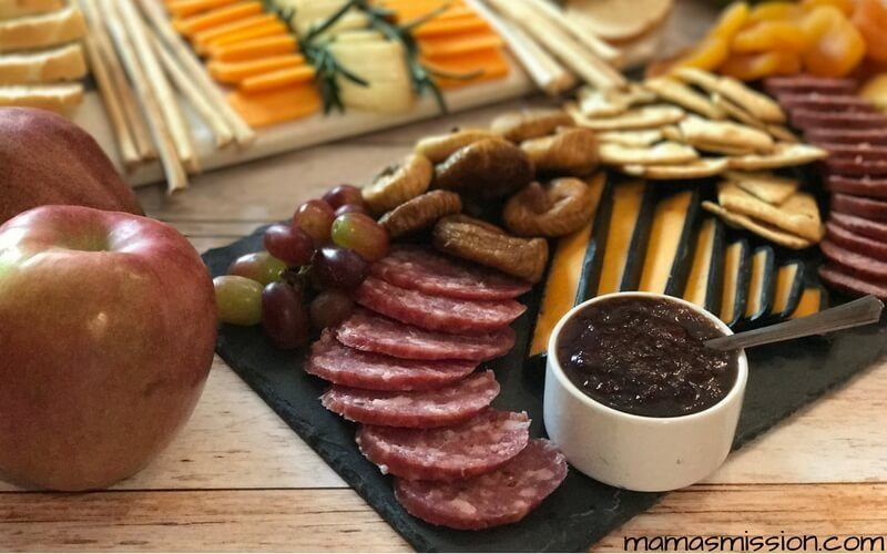 Hosting guests can be fun and easy with these holiday party planning and hosting tips. Create a fun charcuterie board using your favorite cheeses and meats!